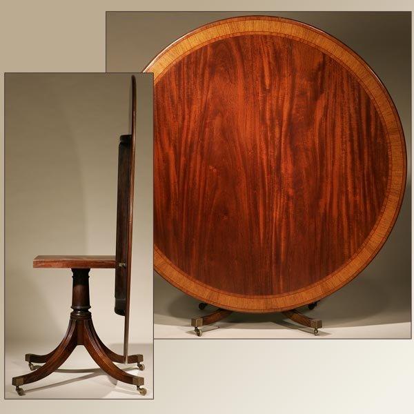 1022: GEORGE III STYLE BANDED MAHOGANY BREAKFAST TABLE