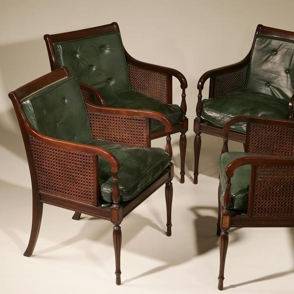 1023: A SET OF FOUR REGENCY STYLE MAHOGANY ARMCHAIRS