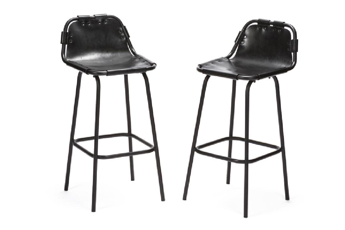 A pair of Charlotte Perriand ''Les Arcs'' bar stools