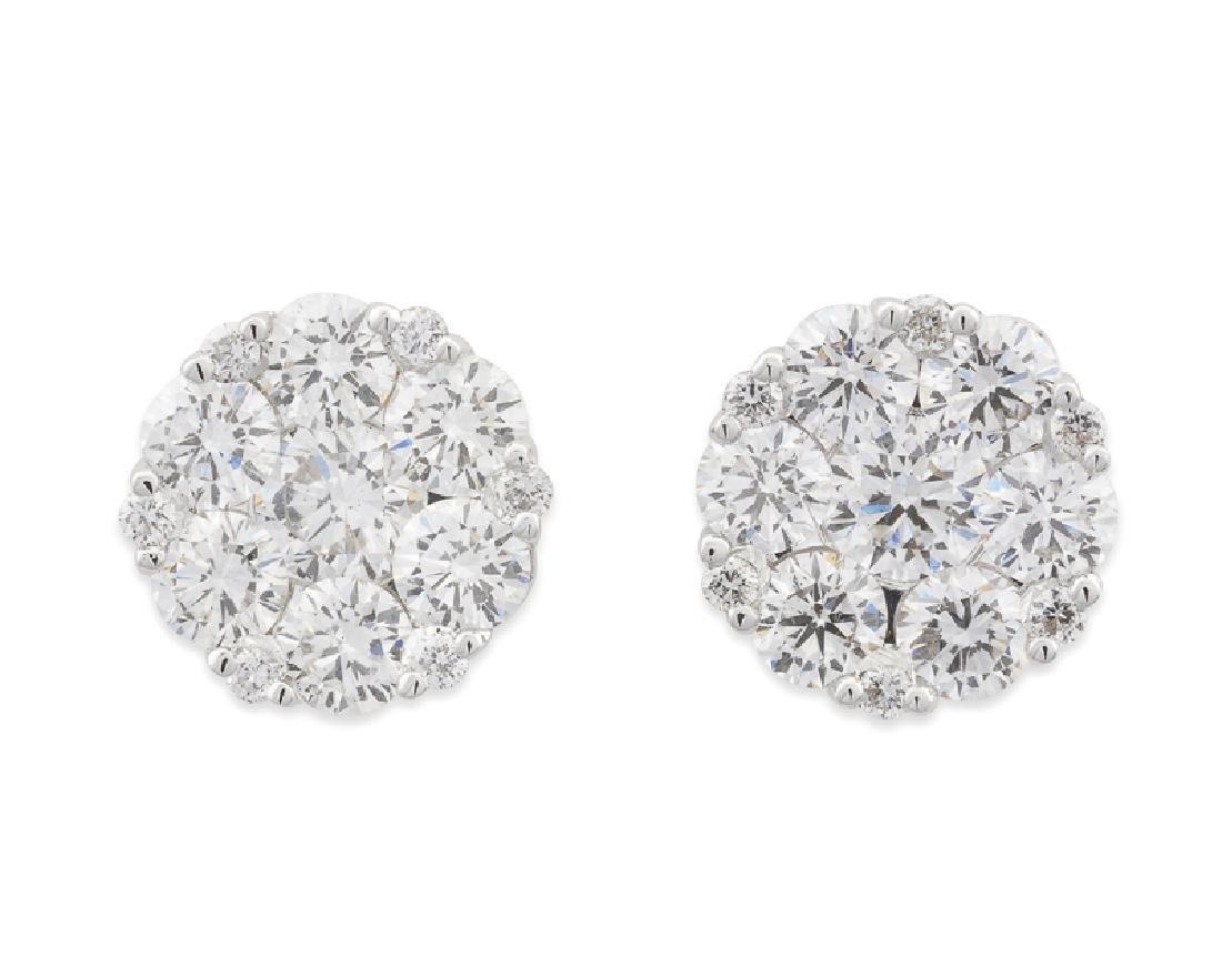 A pair of diamond flower earrings