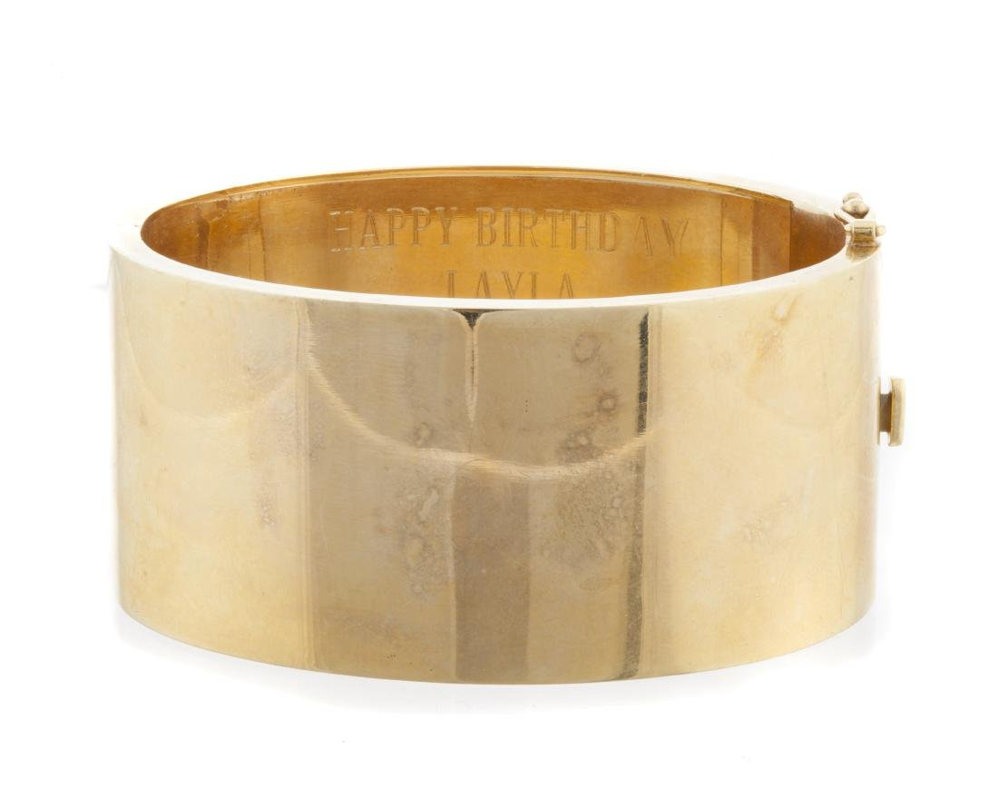 A wide hinged bangle bracelet