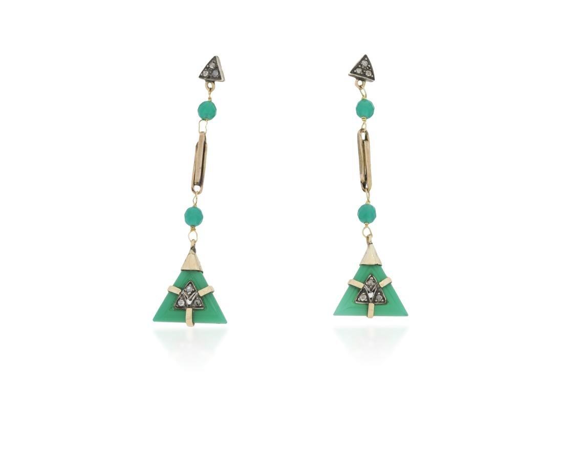A pair of diamond and gemstone earrings