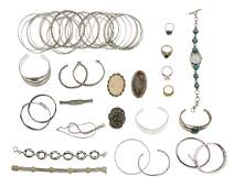 A large group of silver and metal jewelry