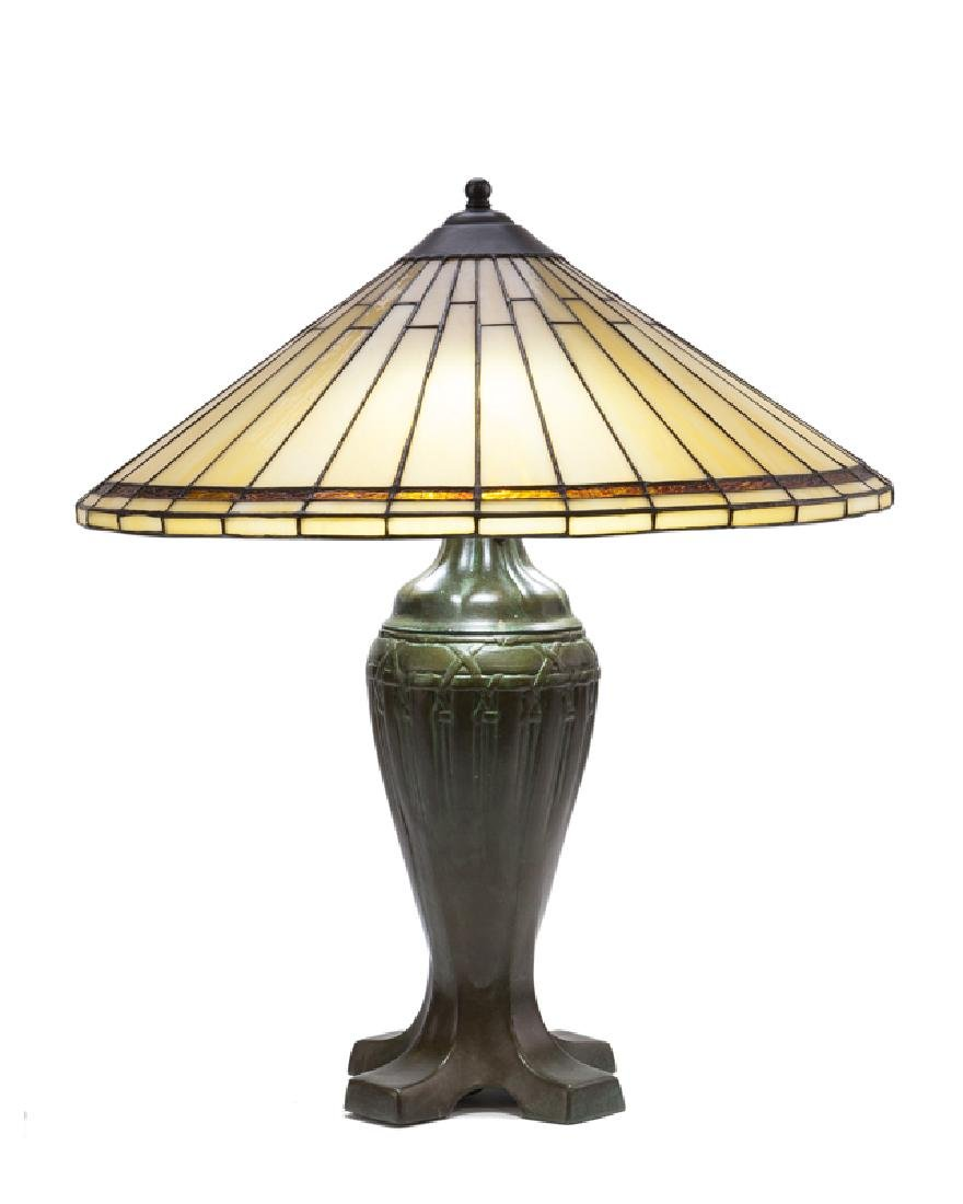 An Arts & Crafts-style lamp and slag glass shade