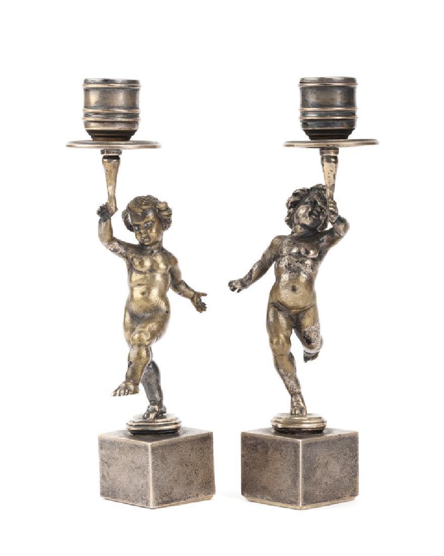 A pair of Buccellati sterling cherub candlesticks