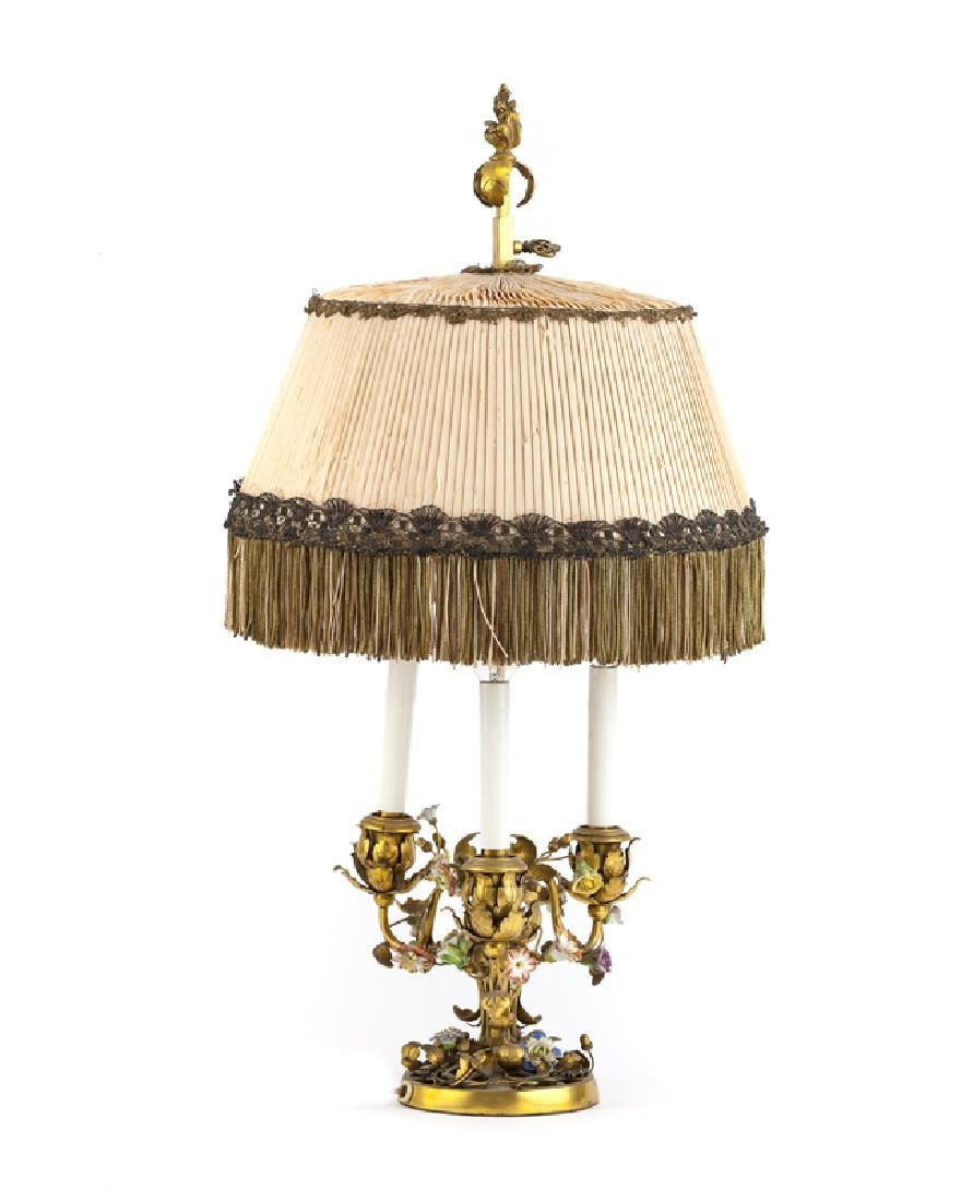A French gilt-bronze and porcelain table lamp