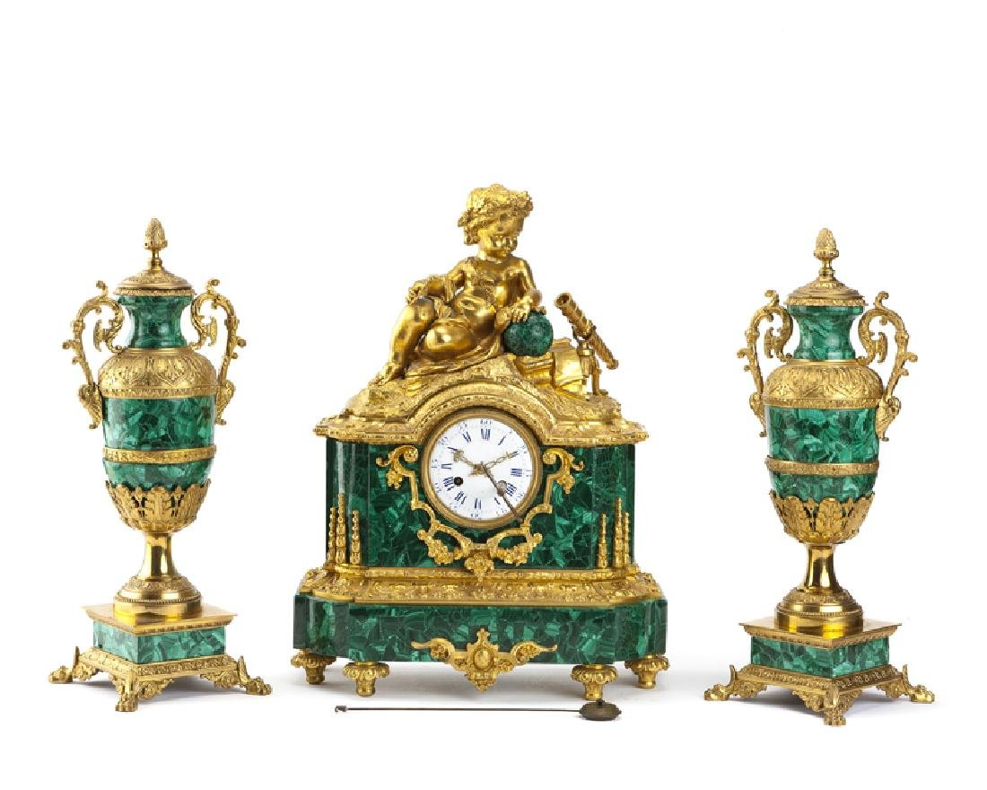 A French gilt-bronze and malachite clock and garniture