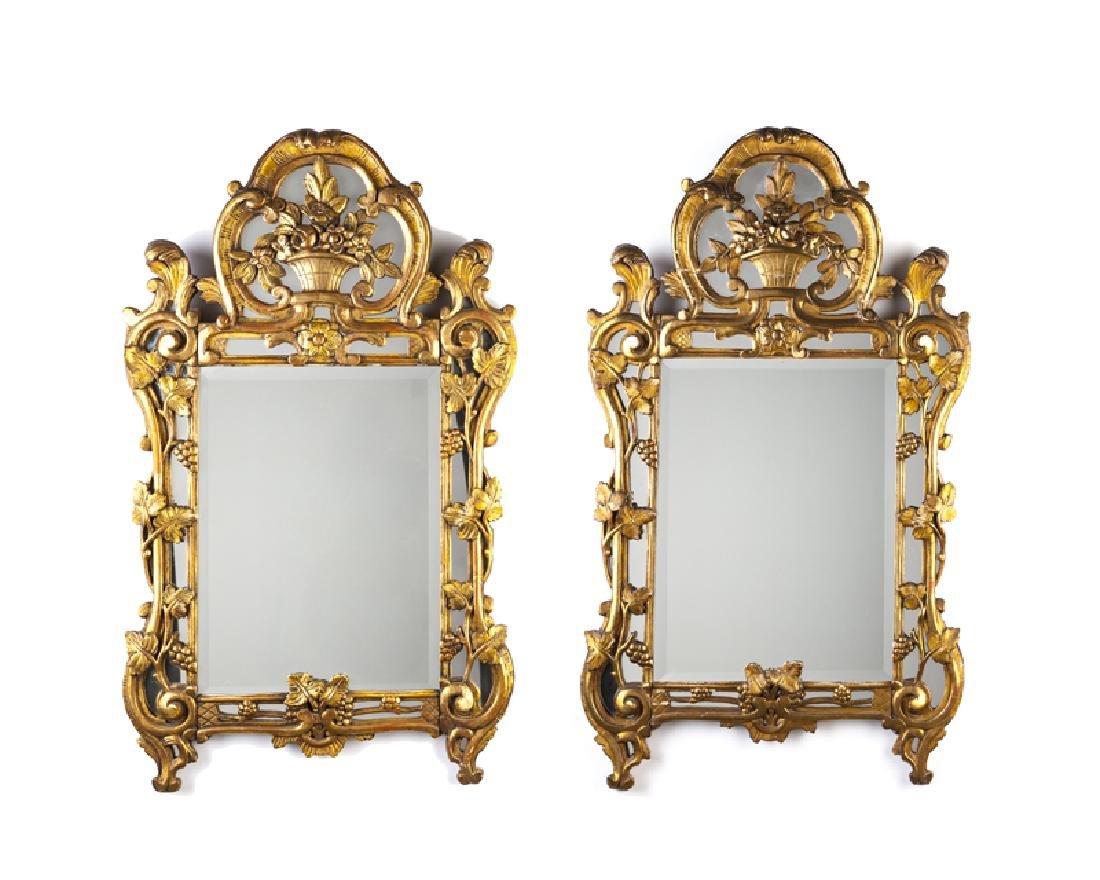 A pair of Continental giltwood wall mirrors