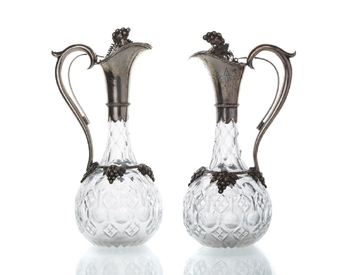 A pair of Chinese silver-mounted crystal ewers