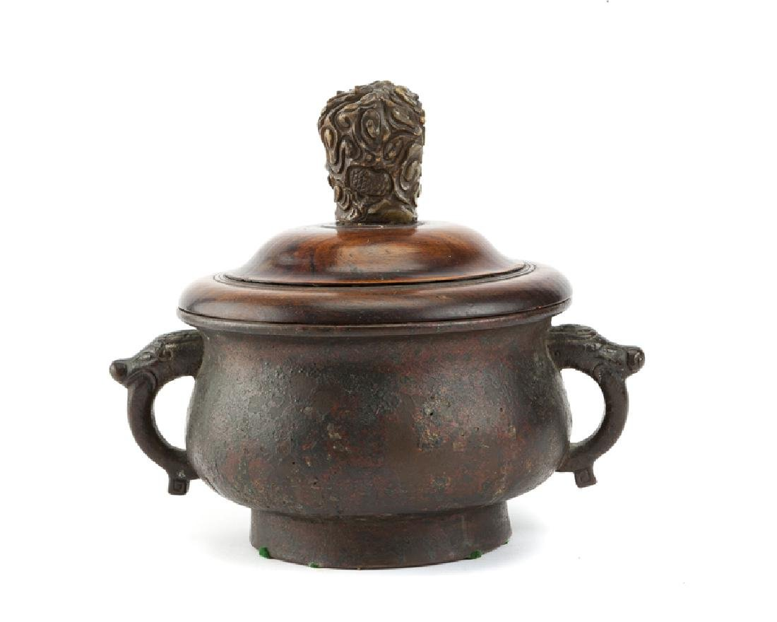 A Chinese bronze, carved stone and hardwood ding