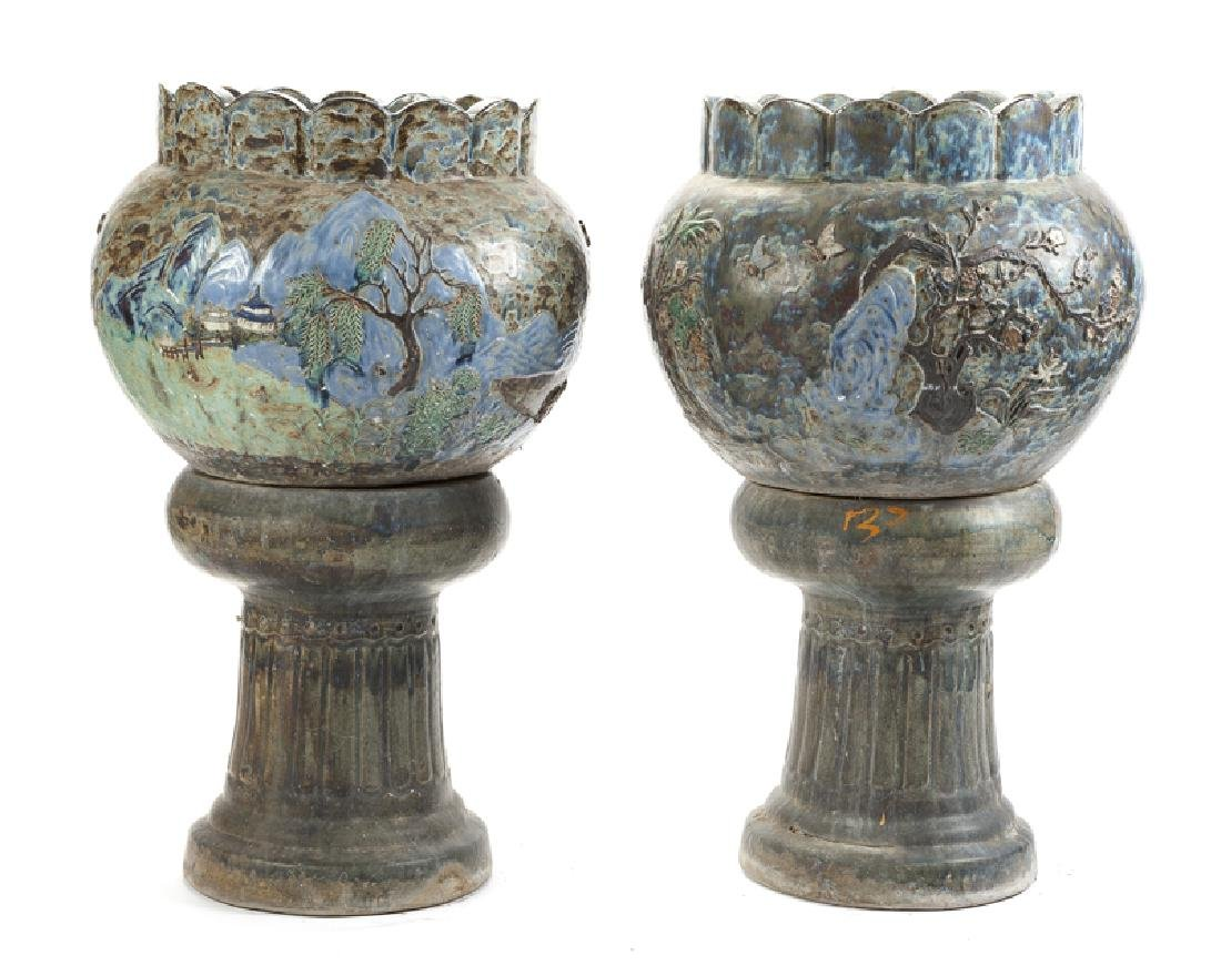 A pair of Chinese pottery jardinieres on pedestals
