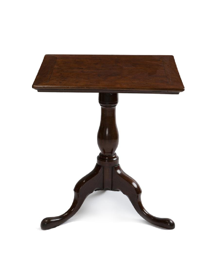 A Georgian-style walnut tilt-top table
