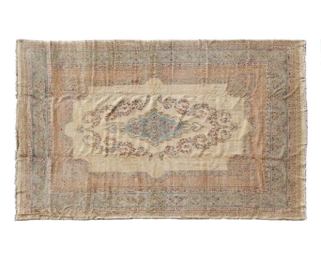 A large Persian Kerman area rug