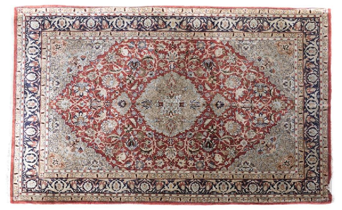 A Persian silk area rug