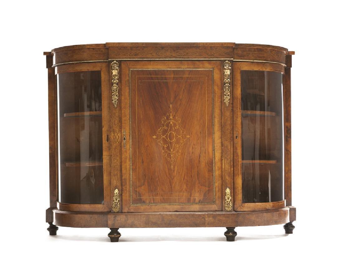 A Victorian demilune vitrine cabinet