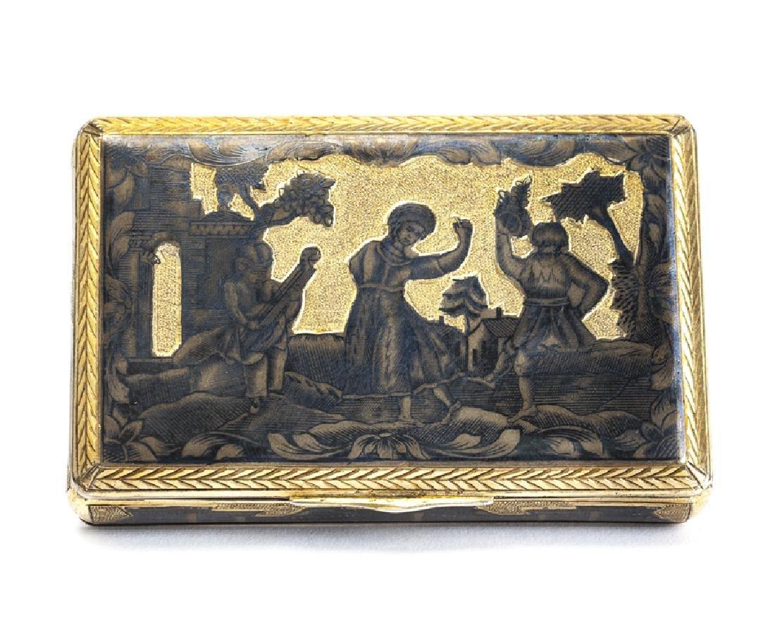 A Russian gilt and silver niello snuff box