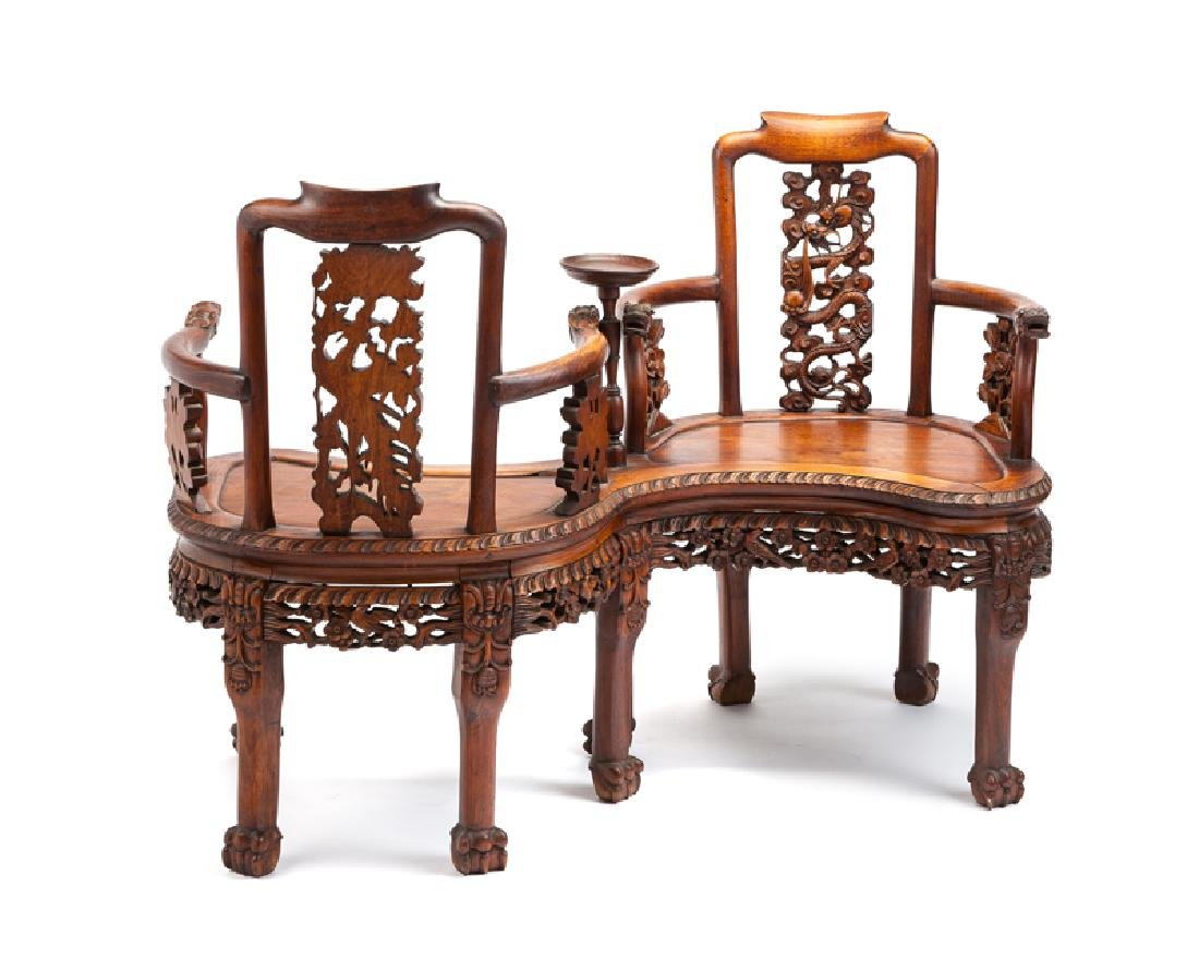 A Chinese carved hardwood tete-a-tete bench
