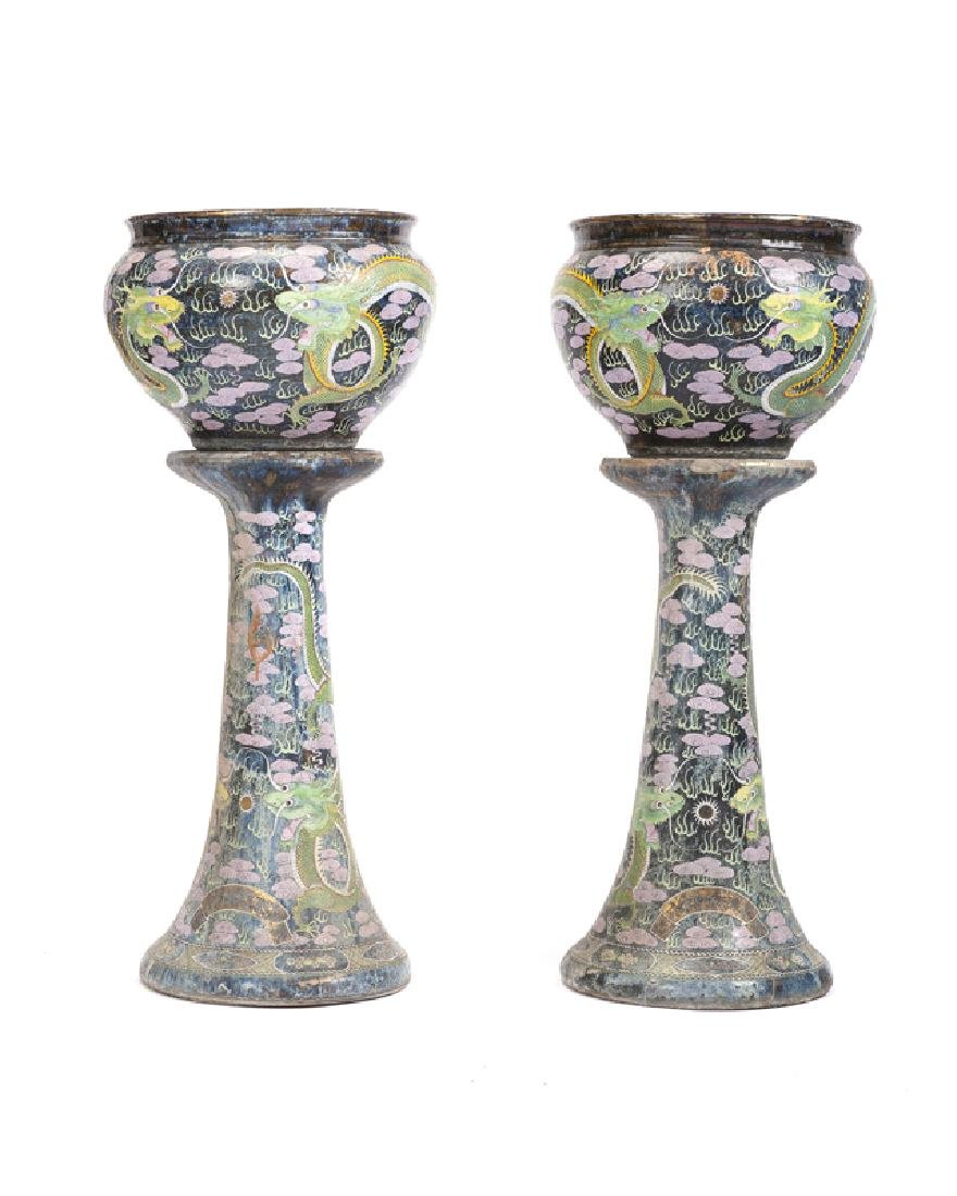A pair of Chinese pottery pedestal jardinieres