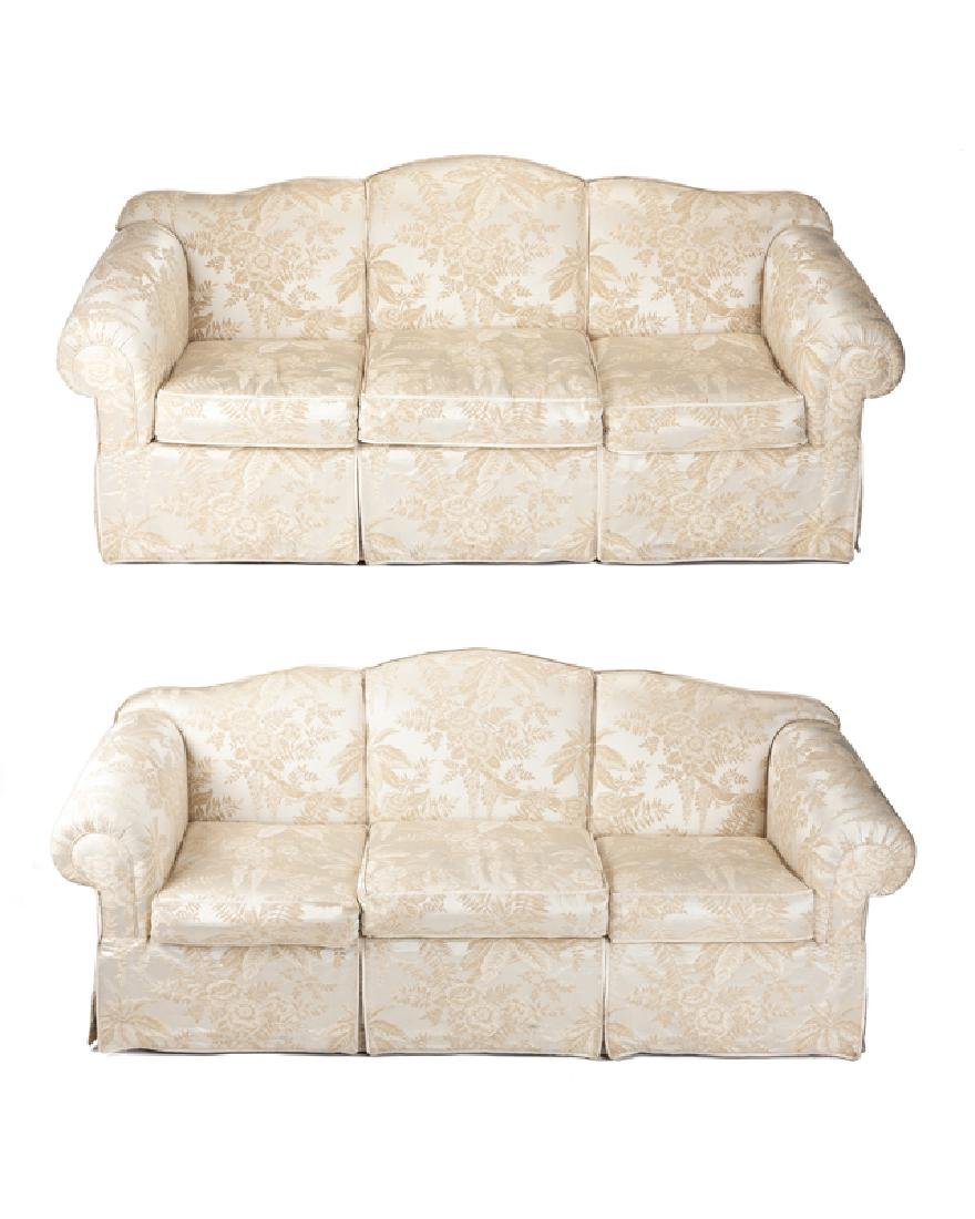A pair of silk-upholstered sofas