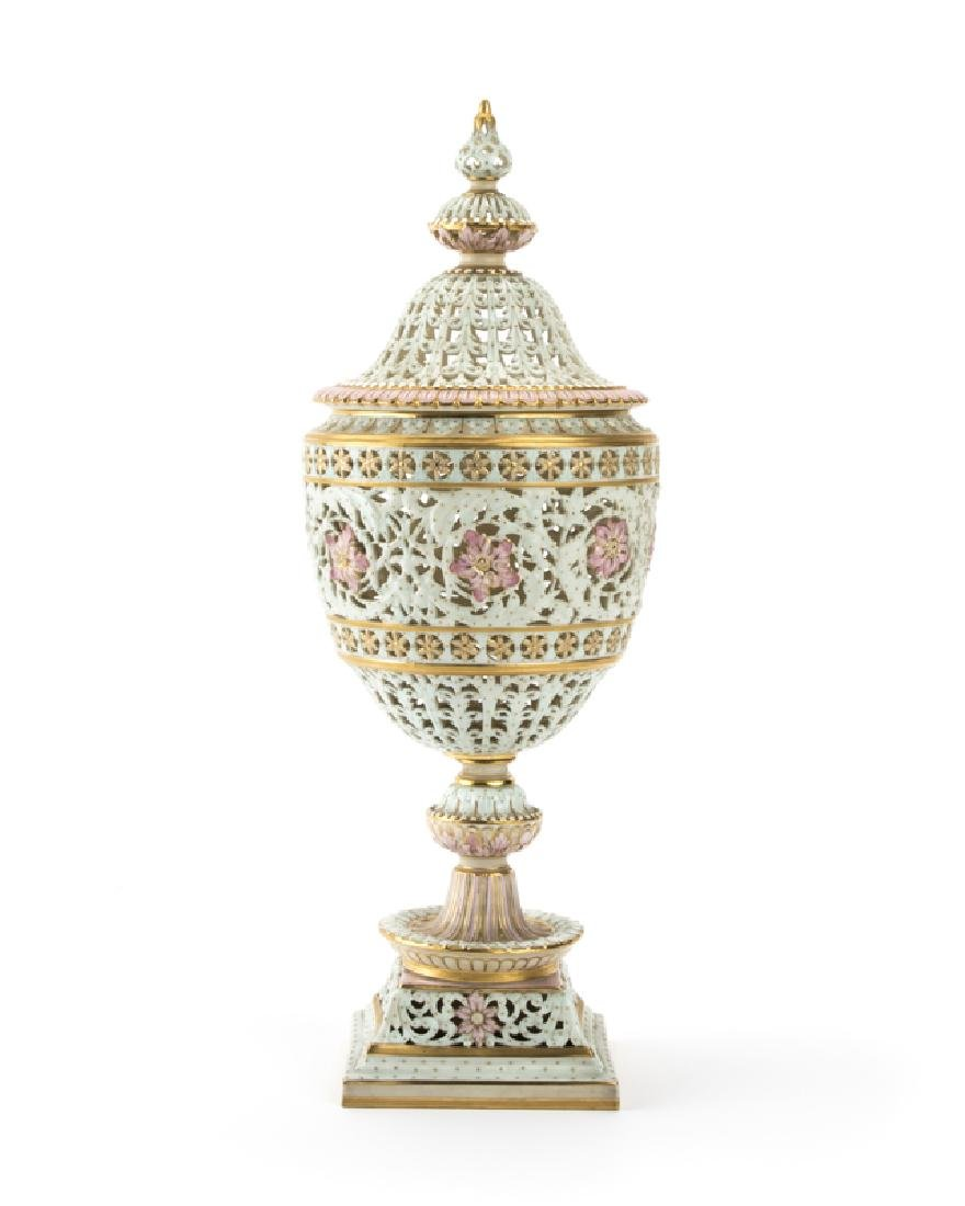 A Royal Worcester reticulated porcelain potpourri urn