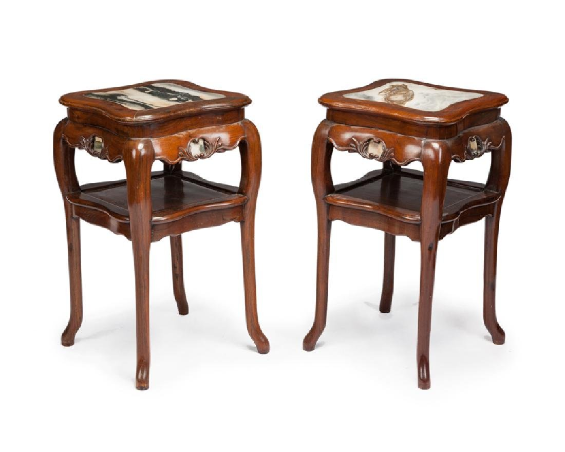 A pair of Chinese carved hardwood lamp tables