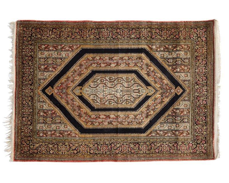 A Persian silk Qum rug