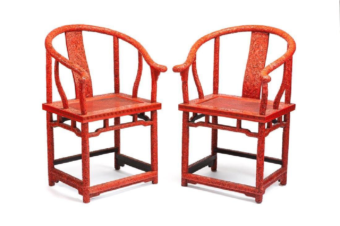 A pair of Chinese carved cinnabar horseshoe chairs