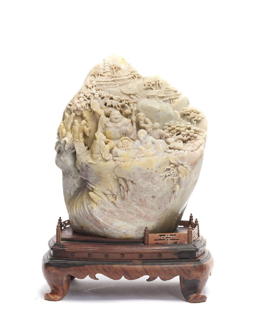 A Chinese carved soapstone sculpture