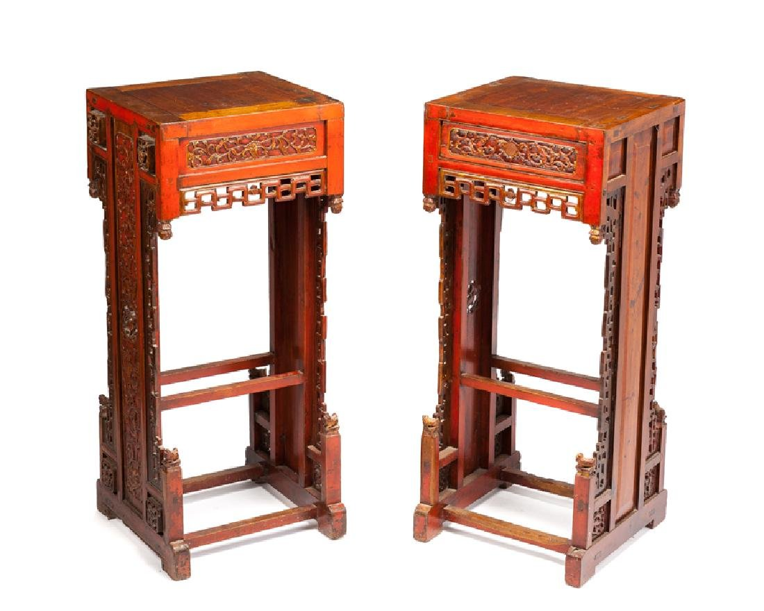 A pair of Chinese carved wood orchid stands