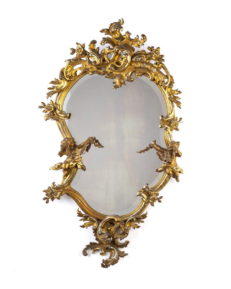 A Louis XV-style carved giltwood wall mirror