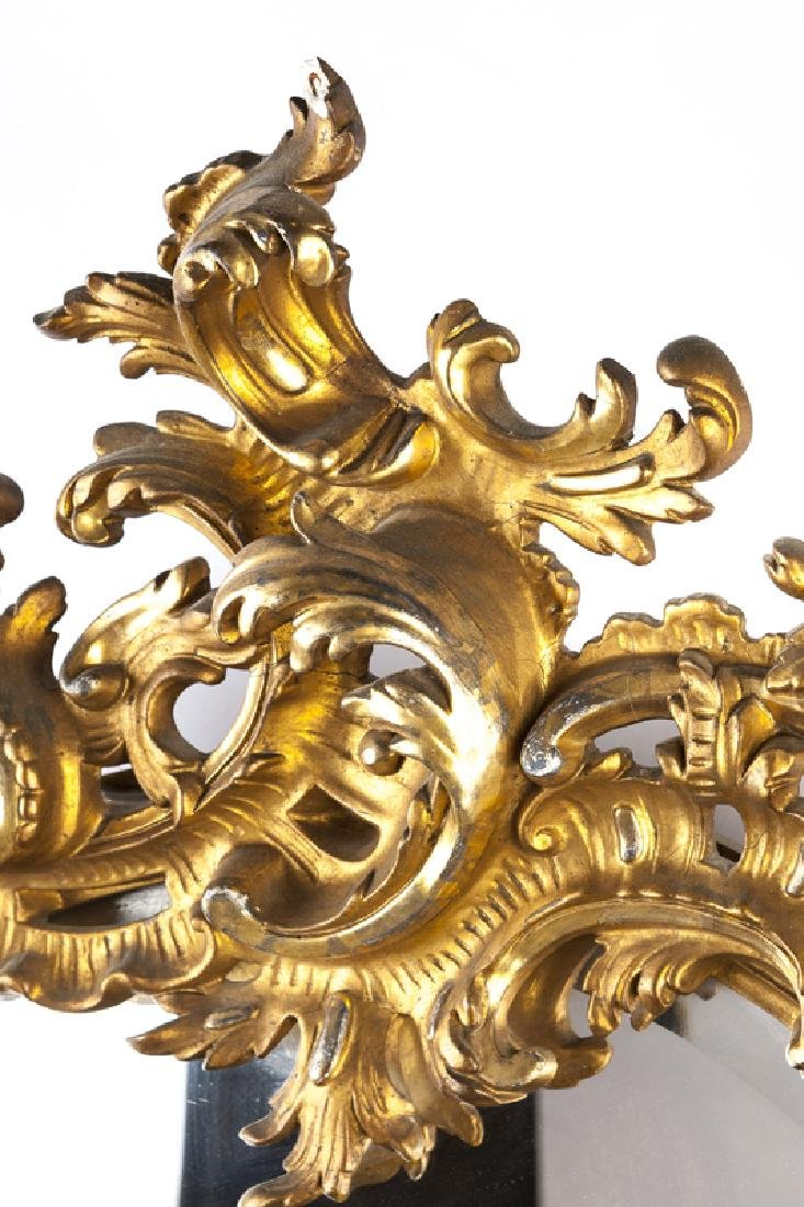 A Louis XV-style carved giltwood wall mirror - 2