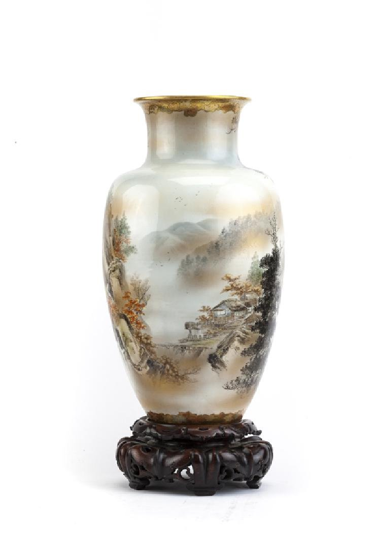 A large Japanese porcelain vase with stand