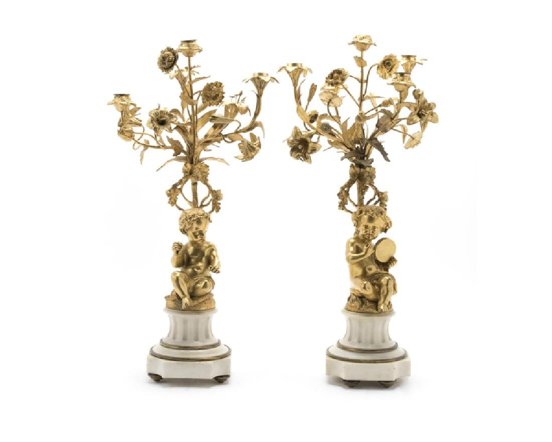 A pair of French gilt-bronze and marble candelabra