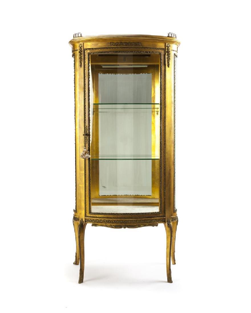 A Louis XV-style bronze-mounted giltwood vitrine