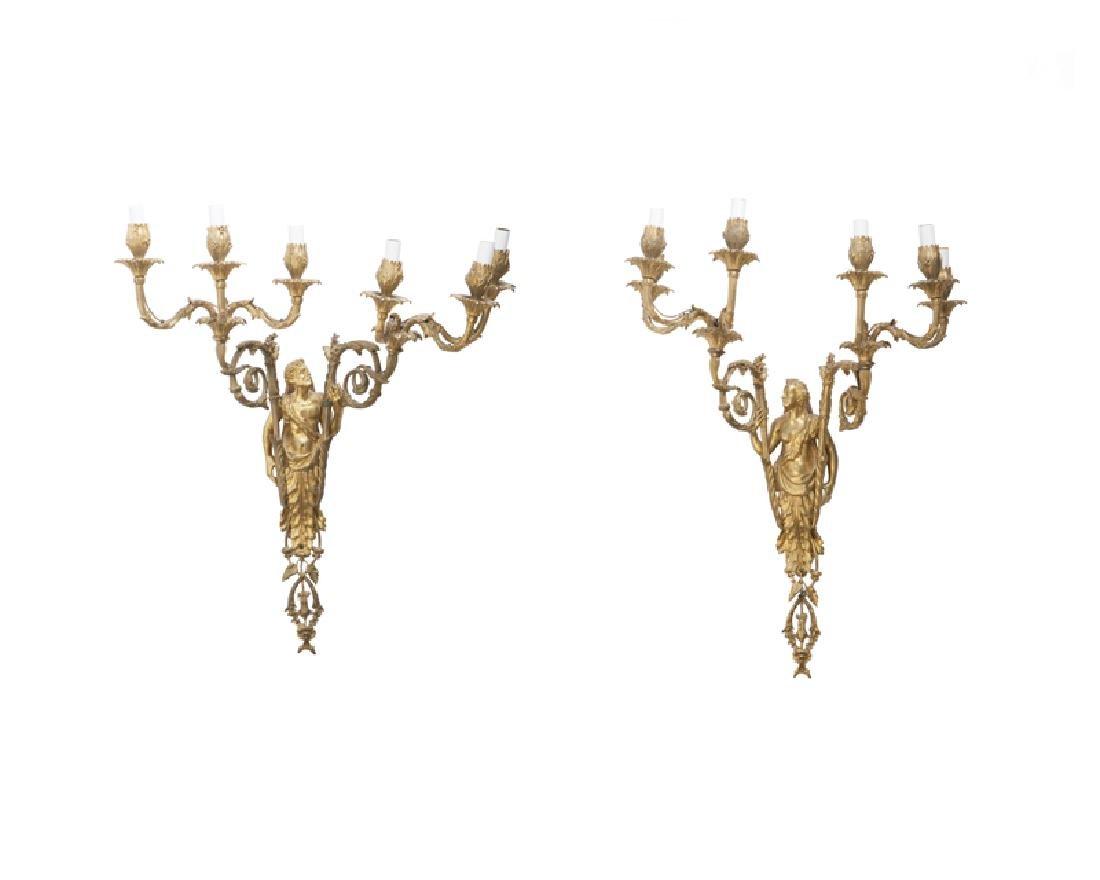 A pair of Louis XVI-style figural gilt-bronze sconces