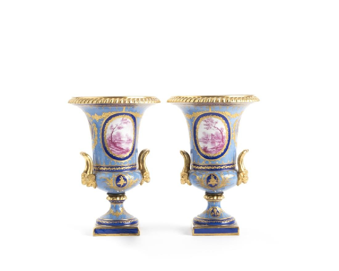 A pair of Sevres-style dual-handled vases