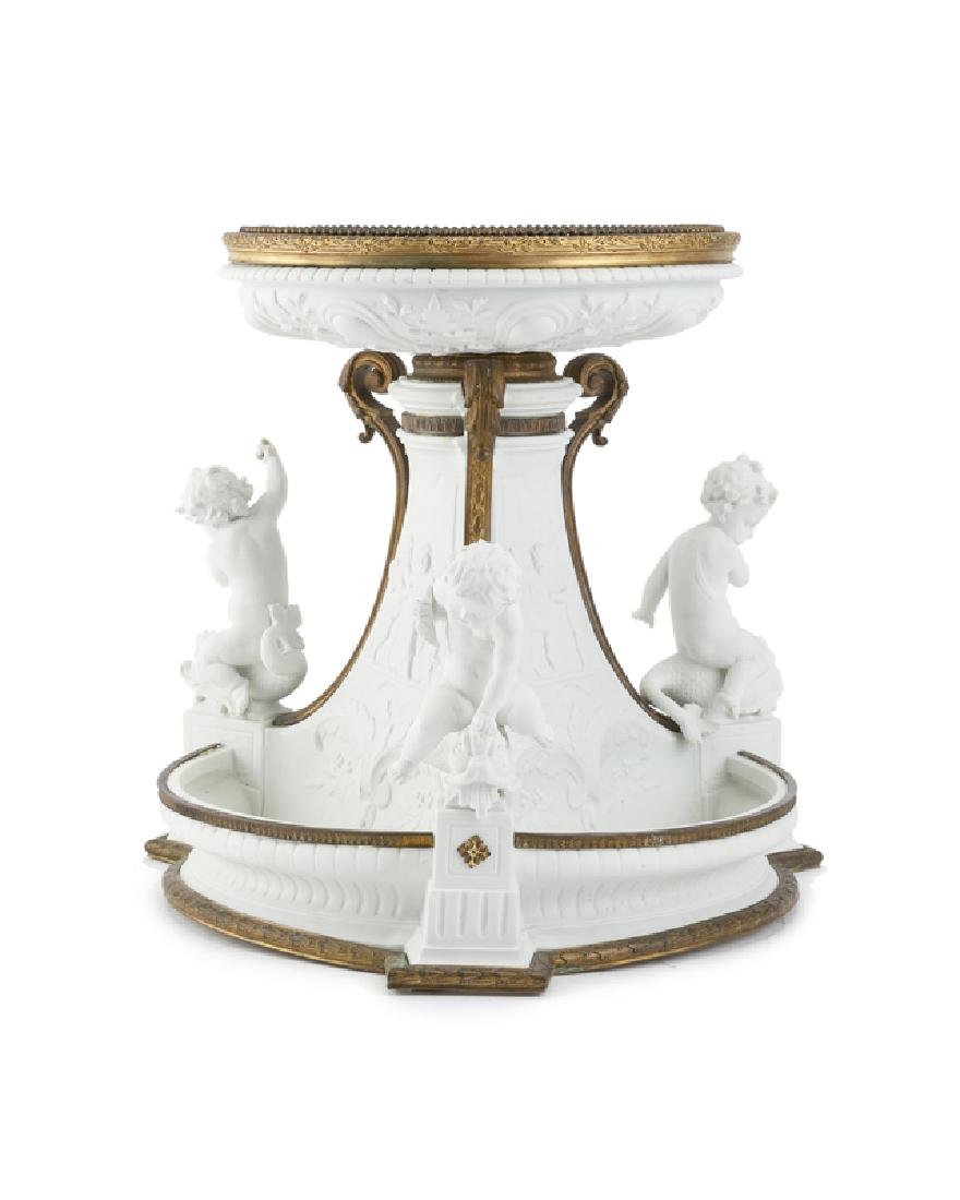 A French gilt bronze-mounted bisque porcelain