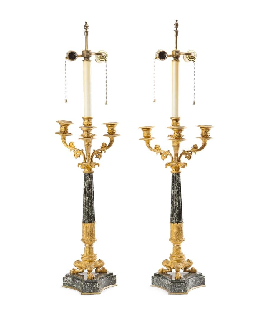 A pair of French Empire-style bronze and marble lamps