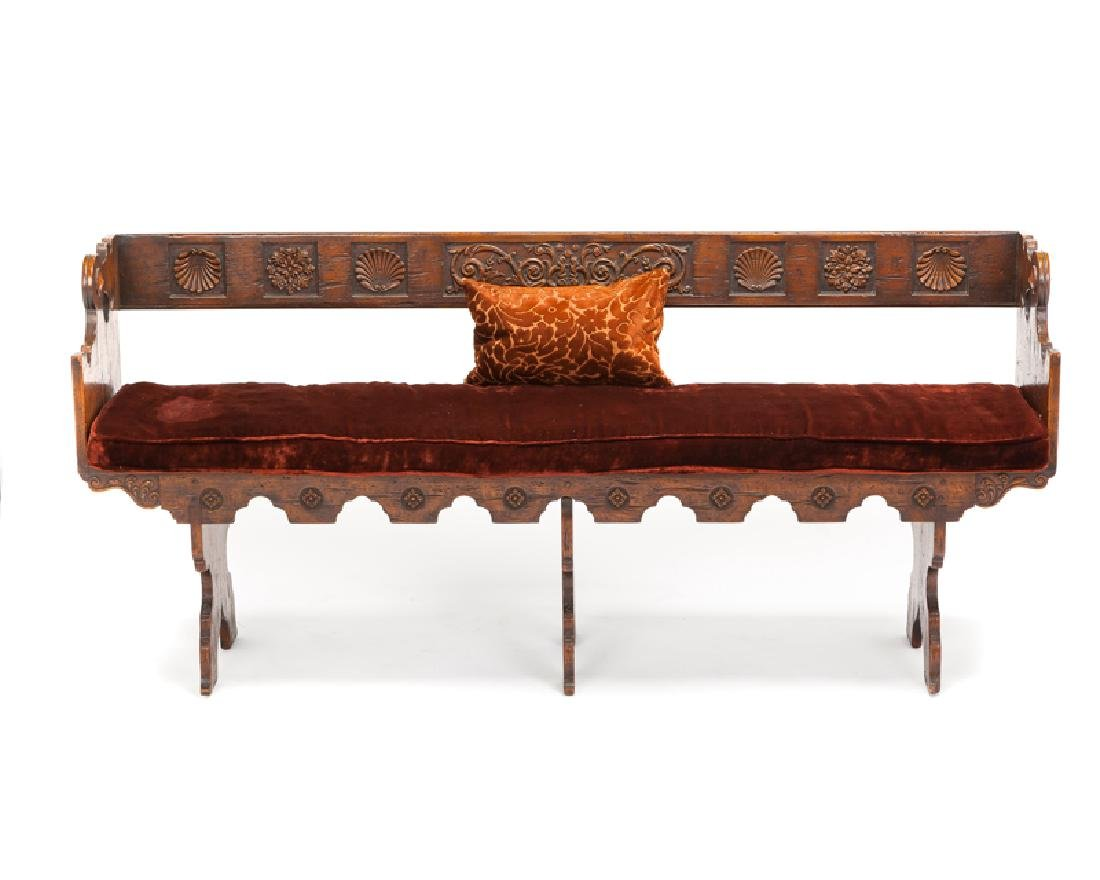 A Spanish Colonial-style carved wood bench