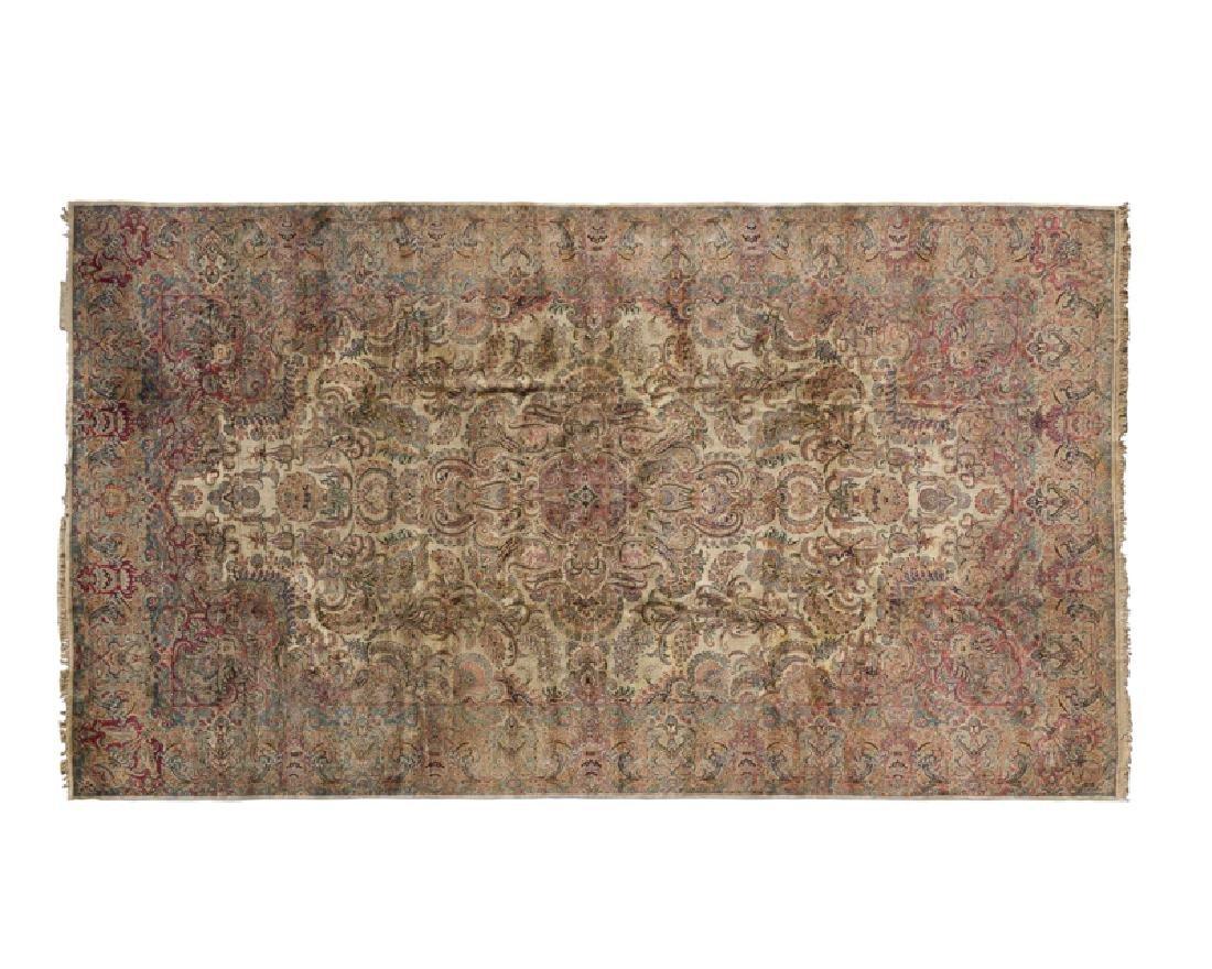 A large Persian Kerman carpet