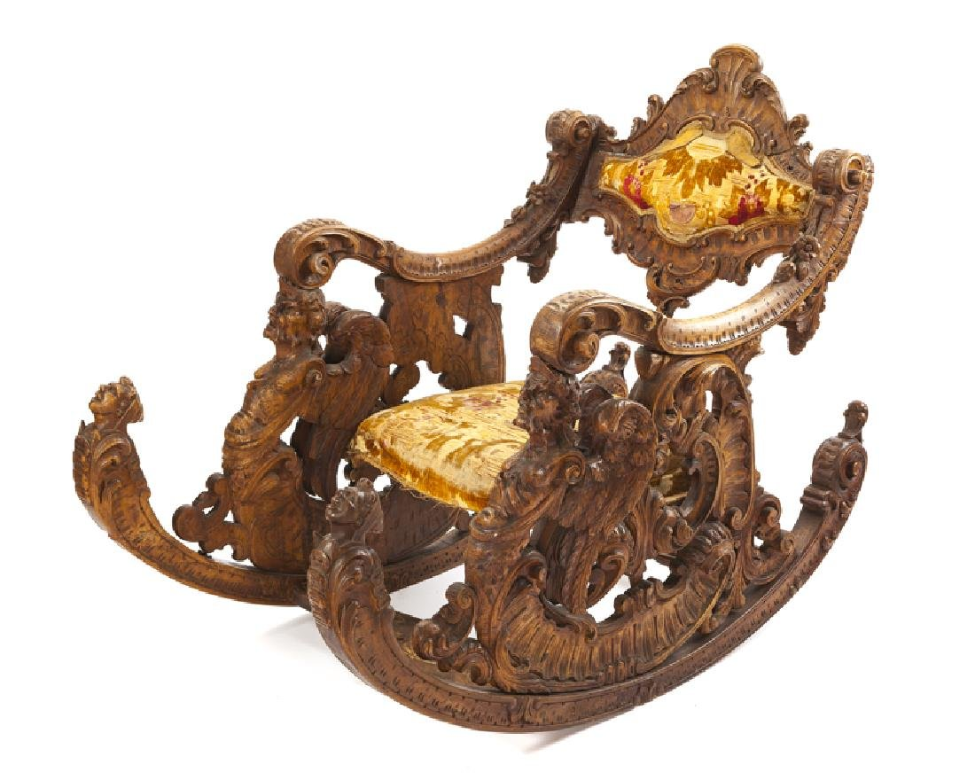 A Venetian gondola-style carved rocking chair