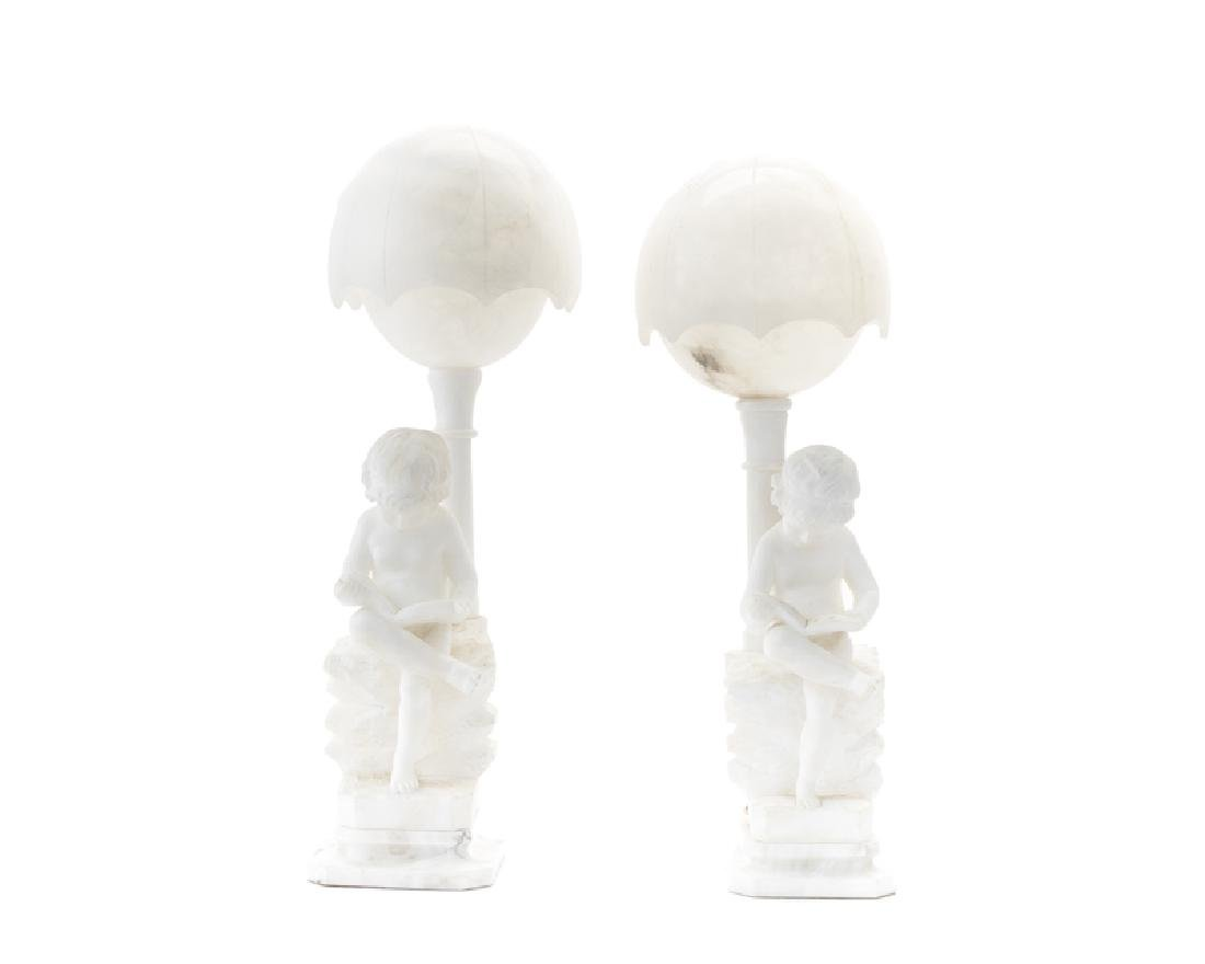 A pair of Italian carved marble lamps