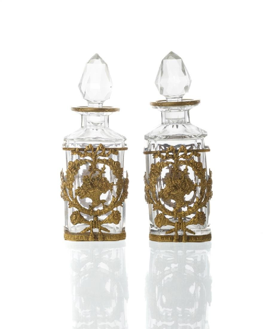 A pair of gilt bronze-mounted Baccarat decanters