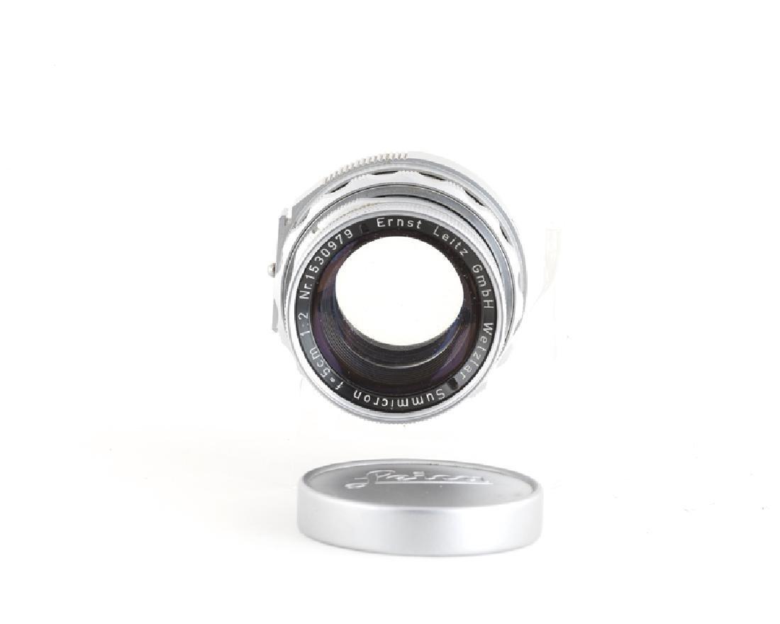 A Leica Wetzlar 13.5 cm 1:45 Hektor lens and f/ 5 cm - 4