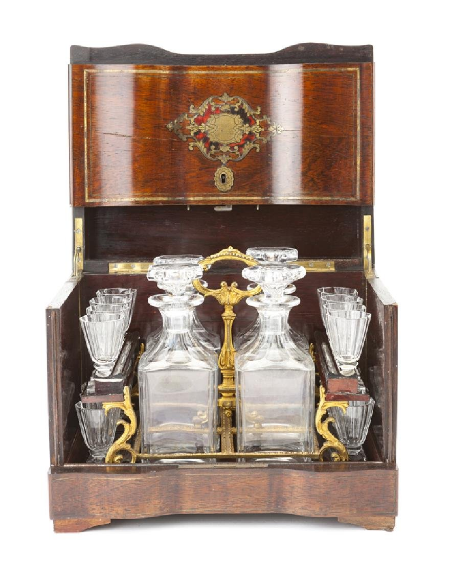 A Continental tantalus with crystal decanters