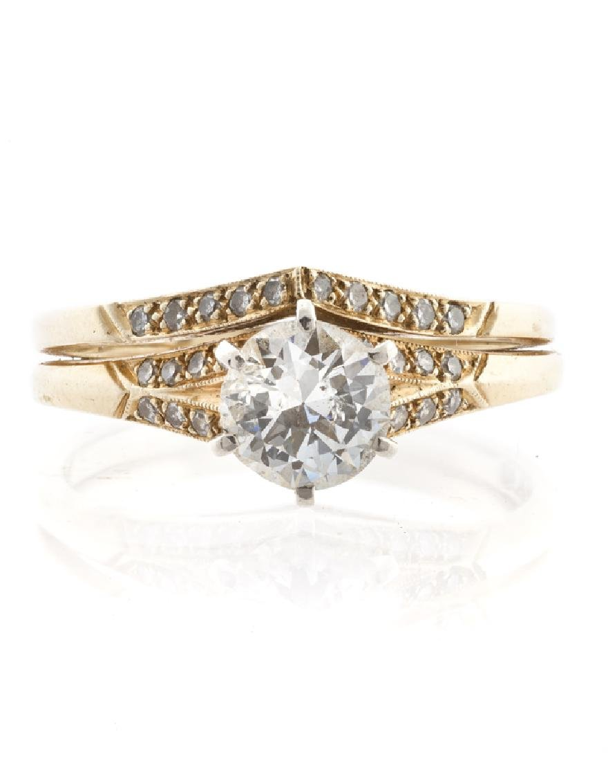 A diamond and yellow gold engagement set