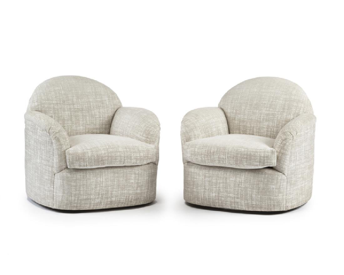 A pair of swivel chairs, attributed to Milo Baughman