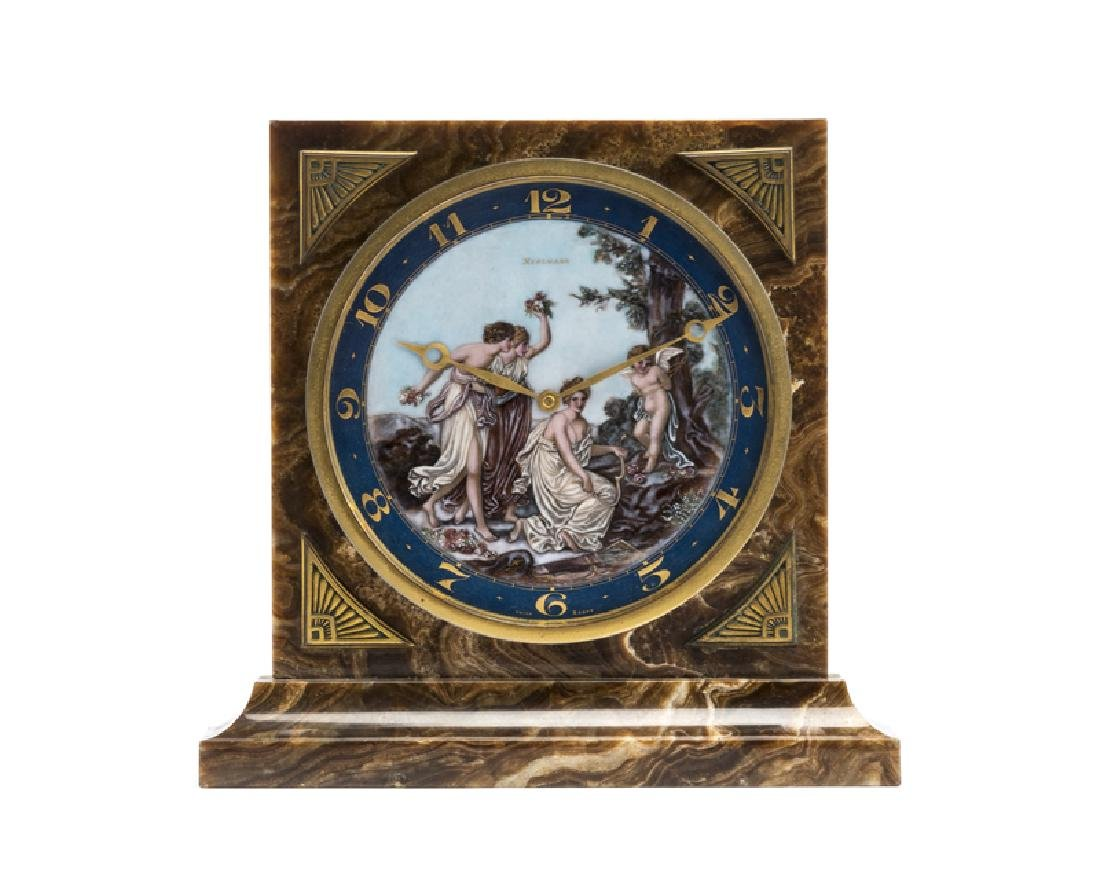 An Art Deco marble and enamel desk clock