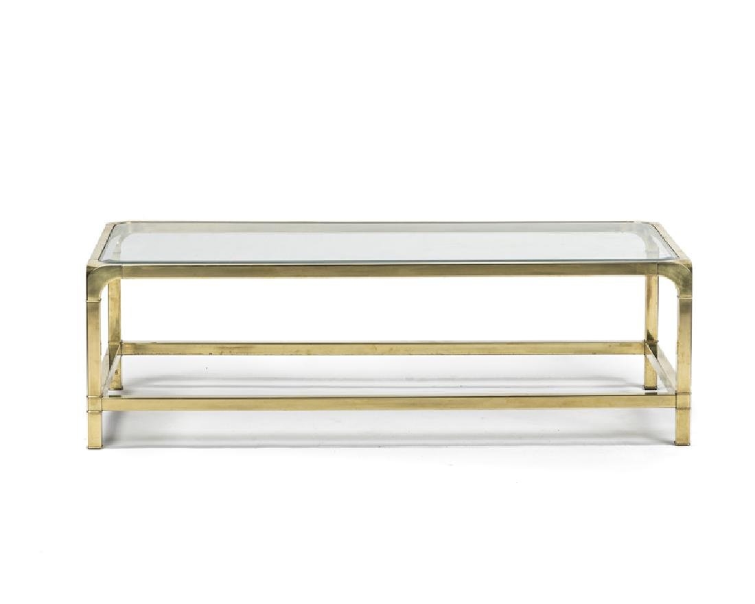 A Mastercraft brass and glass coffee table