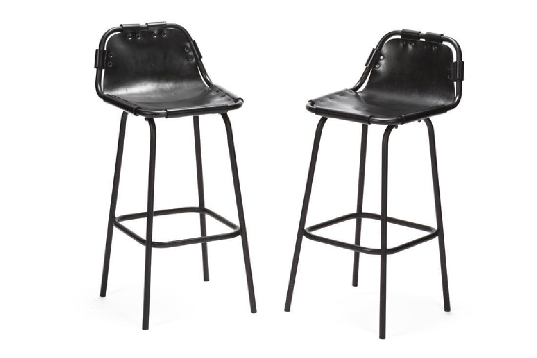 A pair of Charlotte Perriand ''Les Arcs'' bar stools